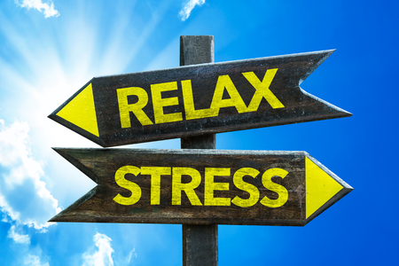stress relief: Relaxstress sign with arrow on sunny background Stock Photo