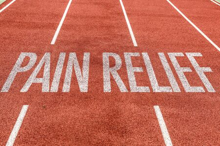 Running track with the word Pain Relief Stockfoto
