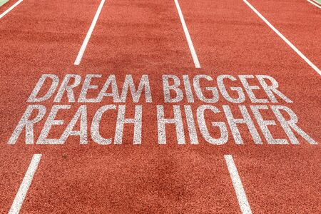 Running track with the word Dream bigger reach higher