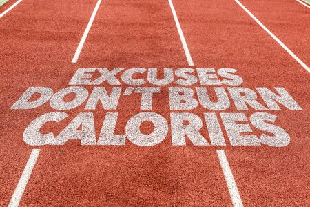 Running track with the word Excuses dont burn calories Stock Photo