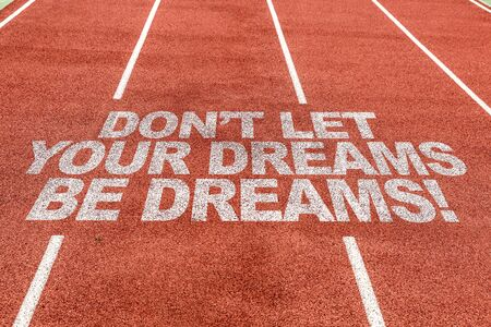 Running track with the word Dont let your dreams be dreams