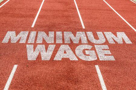 Running track with the word Minimum wage concept Stock fotó - 128886615