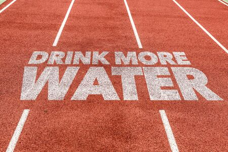 Running track with the word Drink more water Foto de archivo