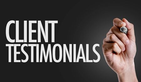 Hand holding a marker with Client testimonials concept