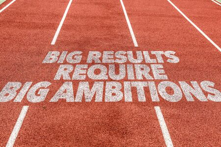 Running track with the word Big results require big ambitions Фото со стока
