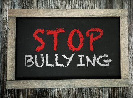 Stop bullying words on a blackboard