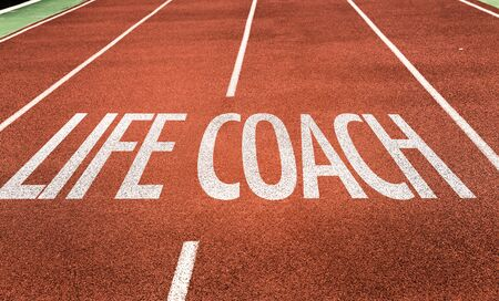 Running track with the words Life Coach Stockfoto