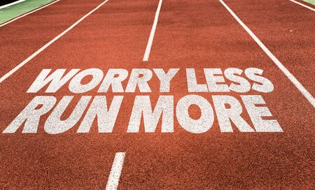 Running track with the words Worry Less Run More