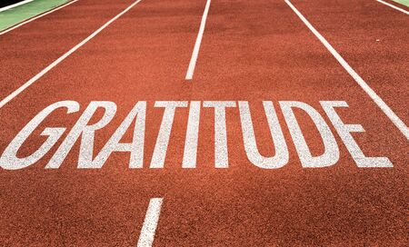 Running track with the word Gratitude
