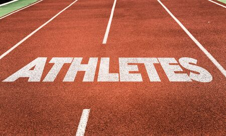 Running track with the word Athletes