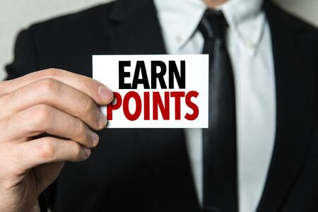 Businessman showing a card with the words Earn Points