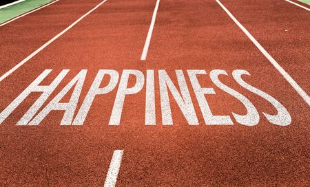 Running track with the words Happiness Stock Photo