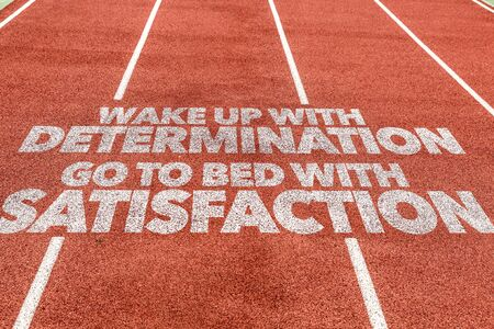 Running track with the words Wake Up With Determination Go To Bed With Satisfaction