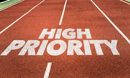 Running track with the words High Priority 스톡 콘텐츠