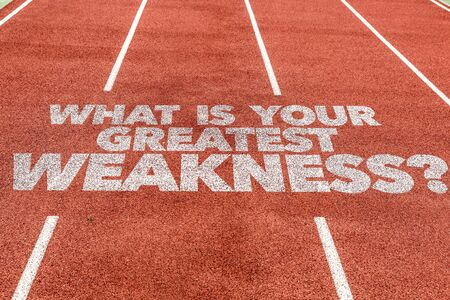Running track with the words What Is Your Greatest Weakness