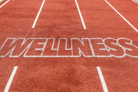 Running track with the word Wellness