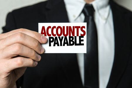Businessman showing a card with the words Accounts Payable