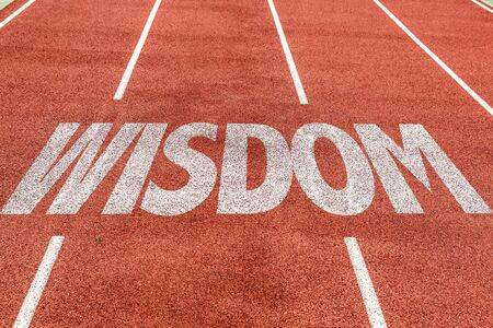 Running track with the word Wisdom