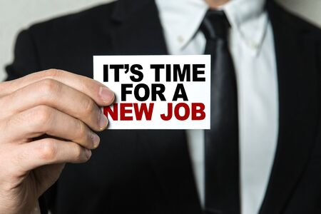 Businessman showing a card with the words Its Time For A New Job Banco de Imagens