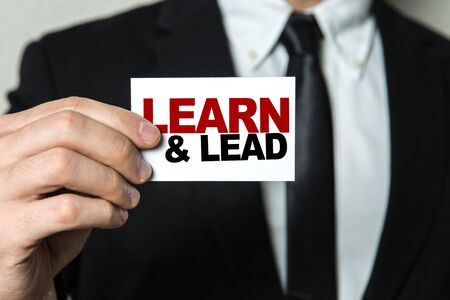 Man holding learn and lead card