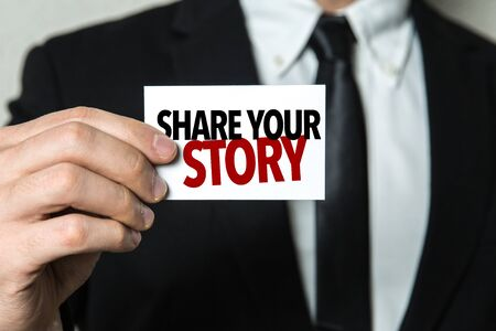 Man holding share your story card