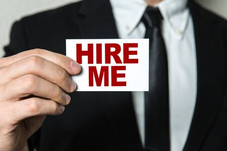 Man holding hire me card
