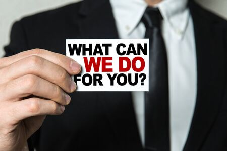 Man holding what can we do for you card