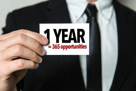 Man holding 1 year 365 opportunities card