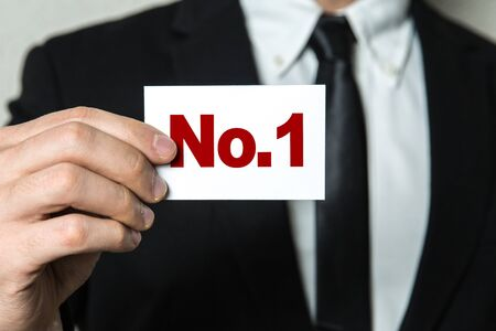 Man holding number one card