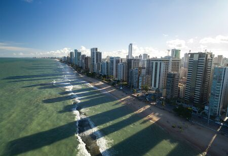 Aerial view of a city by the beach