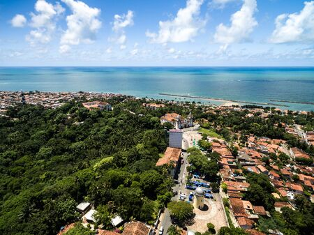 Aerial view of a town by the beach Imagens
