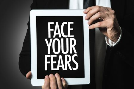 Man holding tablet with face your fears