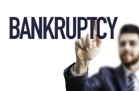 Man pointing at the word bankruptcy
