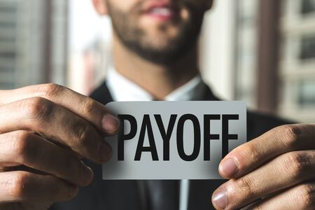 Man holding payoff card Stock Photo