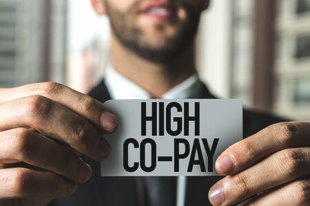 Man holding high co-pay card