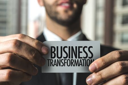 Man holding business transformation card