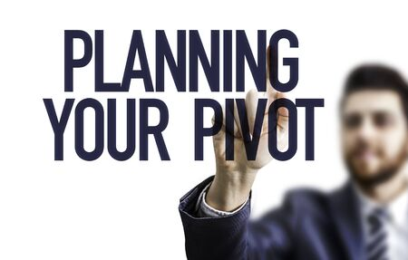 Man pointing at the words planning your pivot Stok Fotoğraf
