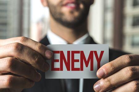 Man holding enemy card Фото со стока