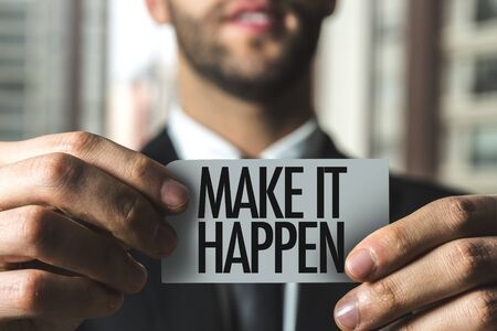 Man holding make it happen card