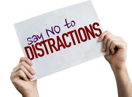 Hands holding Say No To Distractions placard with white background