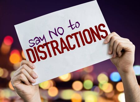 Hands holding Say No To Distractions placard with bokeh background Stock Photo