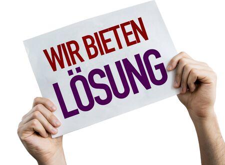 Hands holding Wir Bieten Losung placard with white background