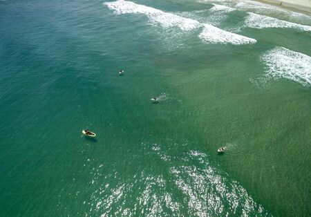 Aerial view of People Surfing, Juquehy, Brazil