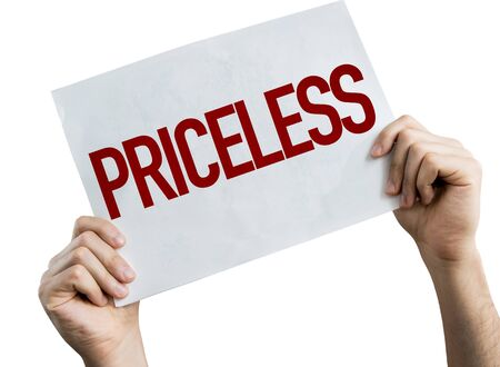 Hands holding Priceless placard with white background