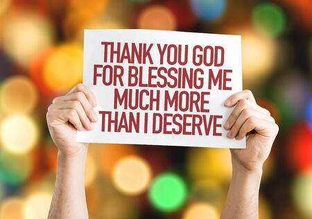 Hands holding for Thank You God placard with bokeh background