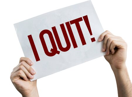 Person holding placard with the words I Quit
