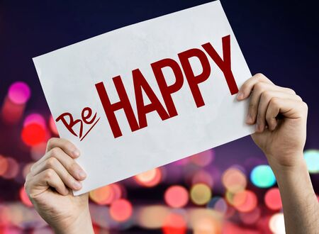 Person holding placard with the words Be Happy Stok Fotoğraf