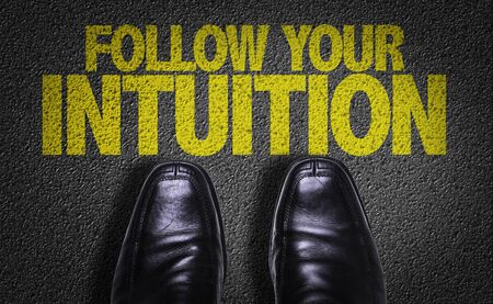 Business shoes on the floor with the words Follow Your Intuition