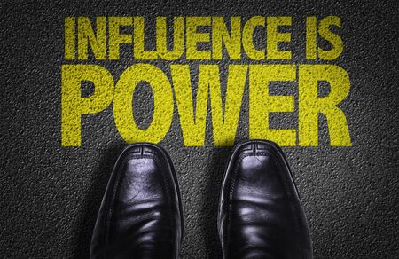 Business shoes on the floor with the words Influence Is Power