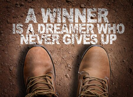 Boots on the trail with the words A Winner Is A Dreamer Who Never Gives Up